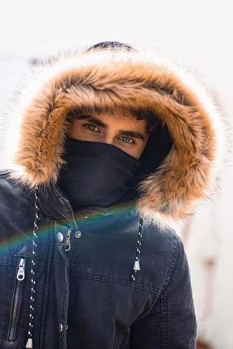 apparel selective focus photography of man wearing parka hoodie hood