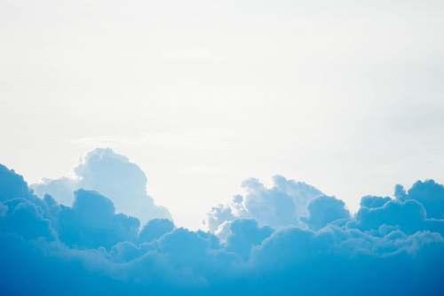 sky blue clouds under white sky nature