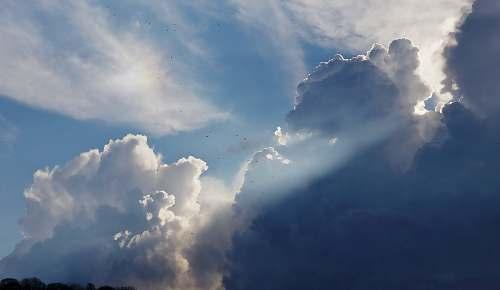 sky cumulunimbus clouds with sun rays nature