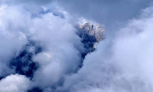 nature rock formation covered with clouds weather