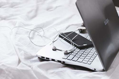electronics iphone face down on laptop keyboard pc