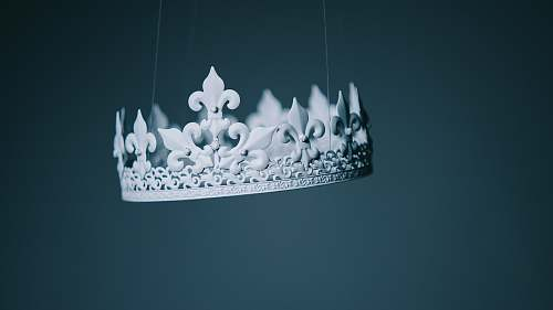 white shallow focus photography white crown hanging decor hanging