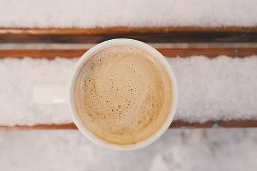 coffee cup of cream frothed coffee winter