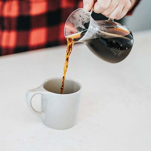 coffee person holding glass pitcher drink