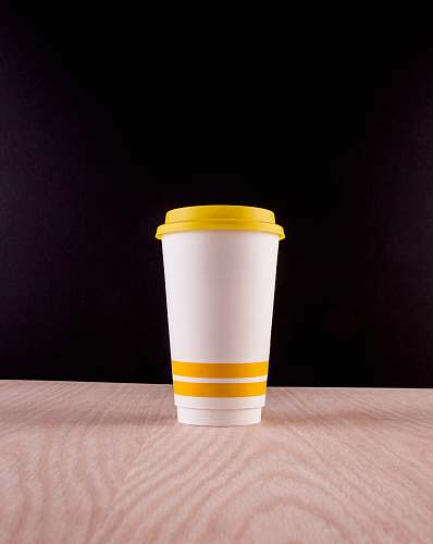 coffee cup white and yellow plastic cup travel cup