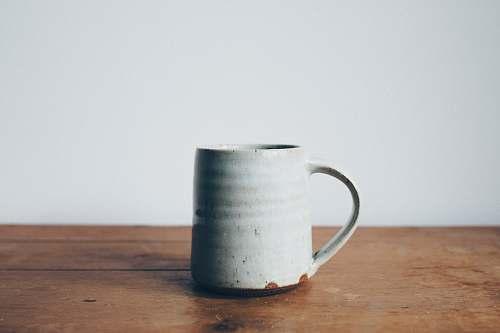 mug white ceramic mug on wooden table top ceramic