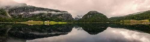 tree mirror reflection photography of mountain range woodland