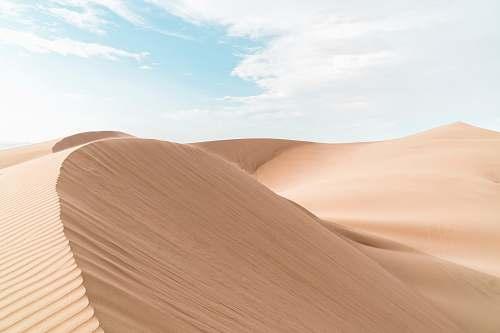 dune landscape photography of desert sand