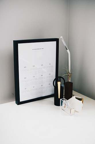 flora calendar with black frame on table jar
