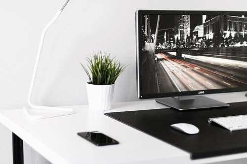 indoors white plant pot beside desk lamp interior design