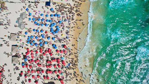 colorful aerial view of people at the beach drone view