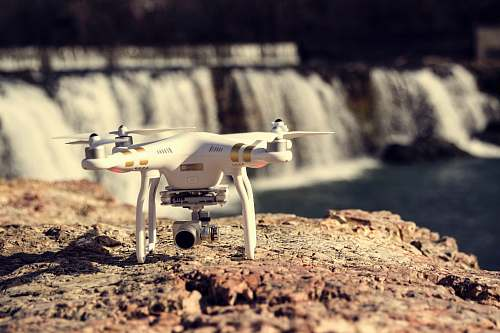rocks white and gold DJI Phantom Professional quadcopter rock