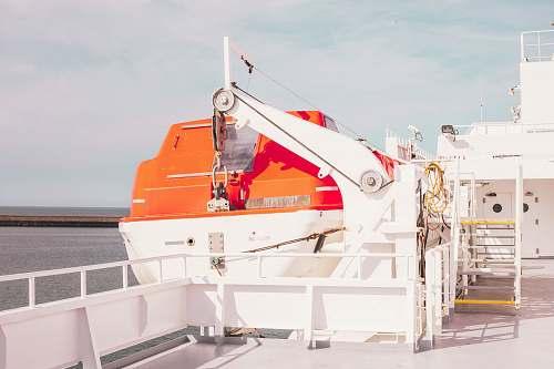 france white ship on body of water during daytime orange