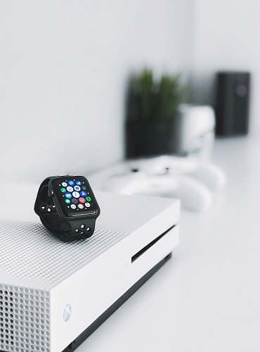 wristwatch black aluminum case Apple Watch on white Xbox One console computer
