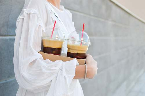 iced coffee woman carrying disposable cups coffee