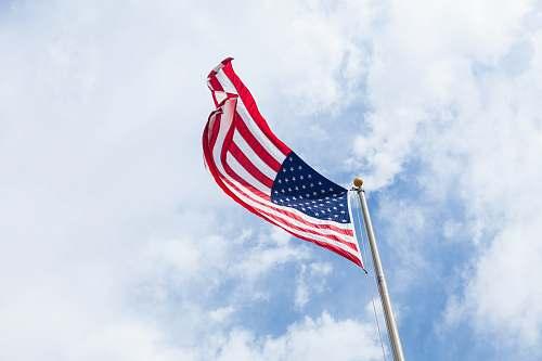 clouds flag of USA with flag pole emblem