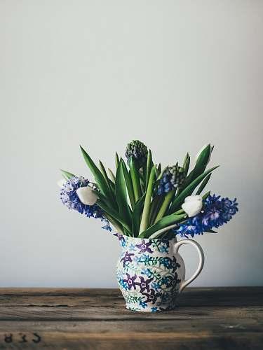 pot flowers on white floral vase on table plant