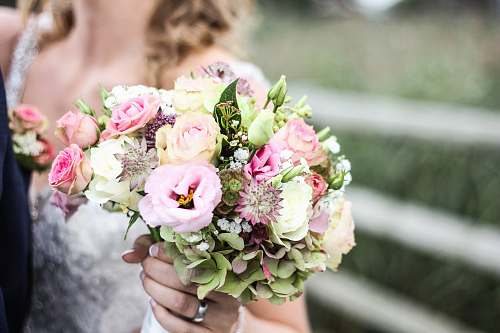 wedding woman holding bouquet of flowers flower arrangement
