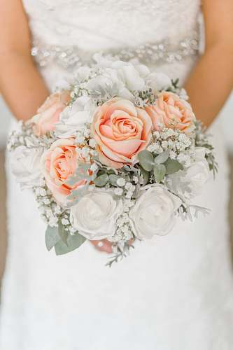 wedding woman holding white and pink rose flower bouquet rose