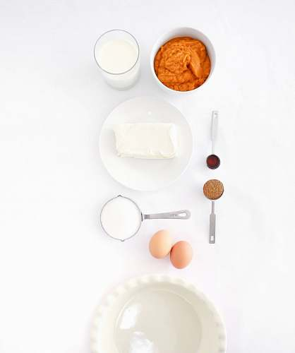 white assorted ingredients on white table igredients