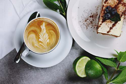 photo coffee flat lay photography of coffee in teacup near plate of sliced cake lime free for commercial use images