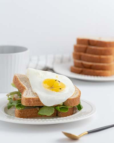 photo bread leaf vegetable with bread and egg breakfast free for commercial use images