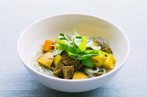 vietnam round white ceramic bowl with sliced meat and vegetable on gray surface bowl