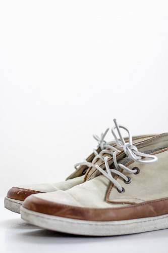 clothing pair of beige chukka boots shoe
