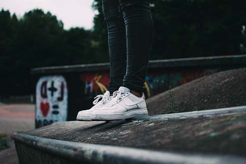 clothing woman standing and wearing white Nike low-top sneakers shoe