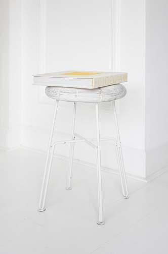 white Mangold box on white stool minimal
