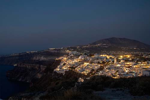 santorini aerial photography of city at nighttime unnamed road