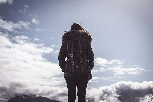 girl woman looking at clouds under blue sky during daytime cloud
