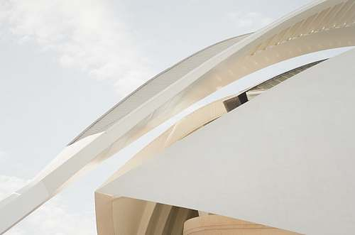 building A long arch at the edge of a modern white facade sky