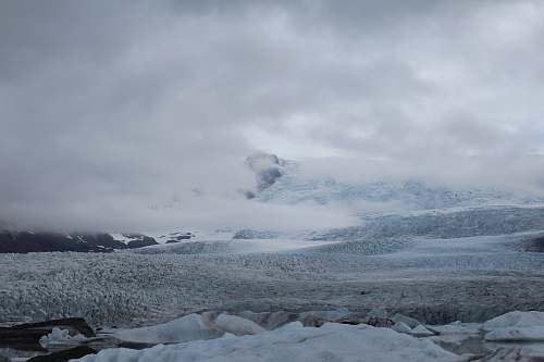 snow frozen hill during cloudy day glacier