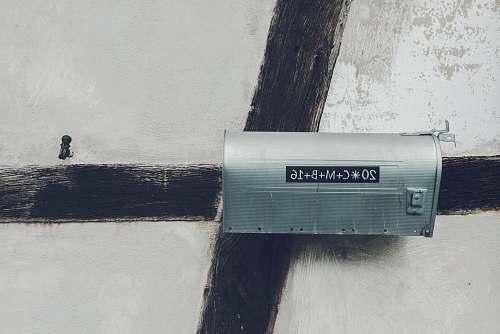 wall gray steel mailbox mailbox