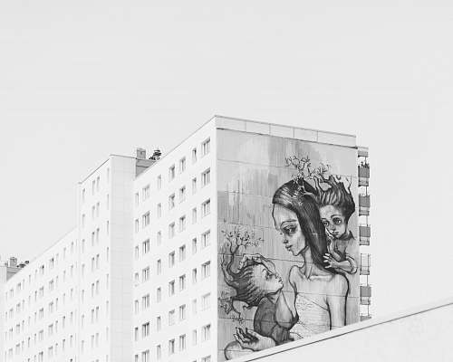 black-and-white grayscale photo of painted building art