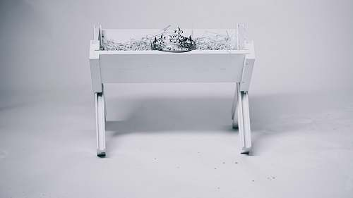 christmas grayscale photography of tiara on table manger