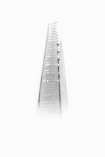 black-and-white high-rise building with fogs architecture