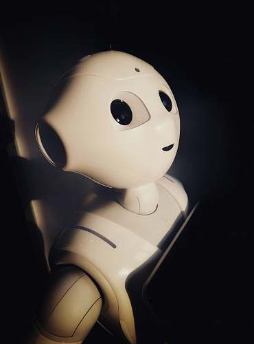robot human robot toy near wall machine learning