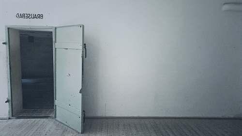 dachau open gray wooden door gas chamber