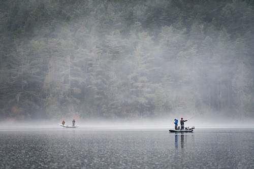 fog people on boat fishing near foggy forest lake campbell