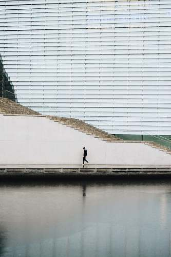 berlin person walking beside concrete staircase wall