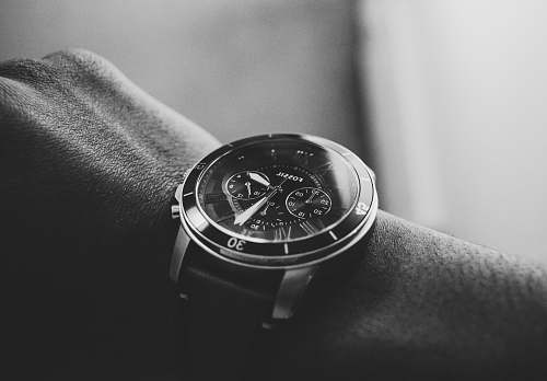 black-and-white person wearing chronograph watch wristwatch