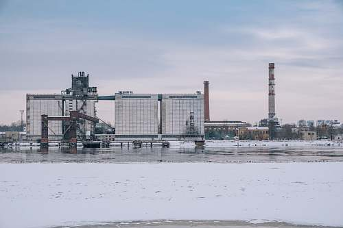 factory photo of white concrete buildings riga