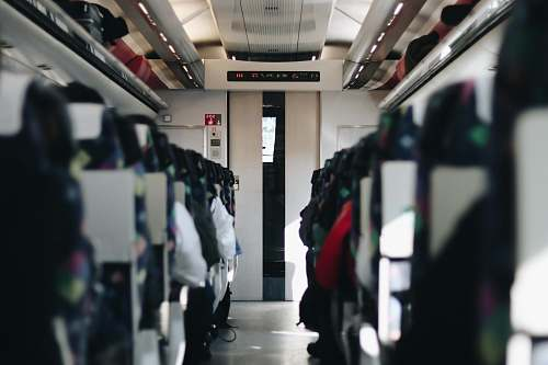 train photography of people sitting in vehicle seating