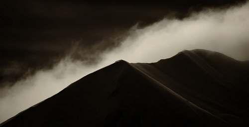 mountain silhouette photo of mountain white