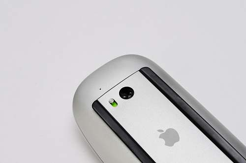 white silver Apple Magic Mouse mouse