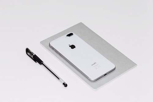 warsaw silver iPhone X beside black ballpoint pen poland