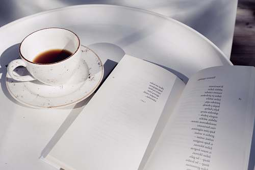 cup white and black ceramic mug coffee cup