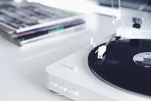 indoors white and black portable turntable electronics